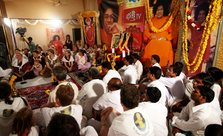 Devotees of Sathya Sai Baba pray for his good health at Puttaparthi on Saturday. PTI File Photo