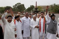 Congress Telangana MPs shout slogans after their resignation, at the Parliament in New Delhi. PTI Photo