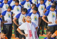 PM Modi performed Yoga with over 50,000 enthusiasts at the Forest Research Institute campus. PTI Photo