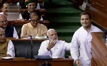 Rahul Gandhi walked across the Well of Lok Sabha to Modi and hugged him, taking the Treasury Bench members by surprise. PTI Photo