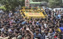 JNU students protesting over steep fee hike clash with police. PTI Photo